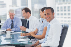 Handsome businessman posing in the meeting room Royalty Free Stock Image
