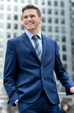 Handsome businessman posing at outdoors stock image