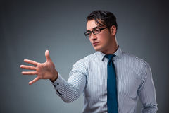 The handsome businessman pressing virtual buttons Royalty Free Stock Photo