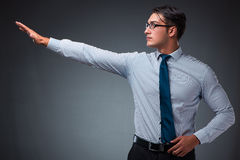 The handsome businessman pressing virtual buttons Stock Photography
