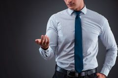 The handsome businessman pressing virtual buttons. Handsome businessman pressing virtual buttons Royalty Free Stock Photo