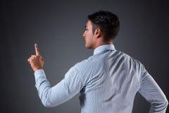 The handsome businessman pressing virtual buttons. Handsome businessman pressing virtual buttons Stock Photos
