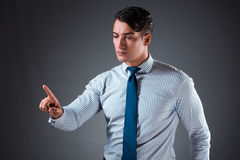 The handsome businessman pressing virtual buttons. Handsome businessman pressing virtual buttons Stock Photography
