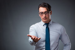 The handsome businessman pressing virtual buttons. Handsome businessman pressing virtual buttons Royalty Free Stock Photography