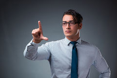 The handsome businessman pressing virtual buttons. Handsome businessman pressing virtual buttons Stock Images