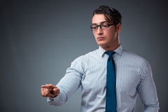 The handsome businessman pressing virtual buttons. Handsome businessman pressing virtual buttons Stock Photo