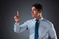 The handsome businessman pressing virtual buttons. Handsome businessman pressing virtual buttons Stock Image