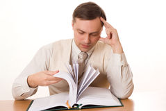Handsome Businessman Reading A Book On White Royalty Free Stock Photo