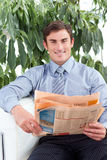 Handsome businessman reading a newspaper Royalty Free Stock Photos