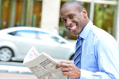Handsome businessman reading a newspaper Royalty Free Stock Images