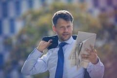 Handsome businessman reading newspaper Stock Photos