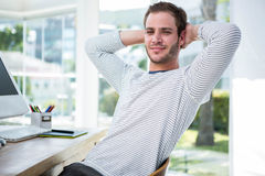 Handsome businessman relaxing on his desk chair Stock Photo