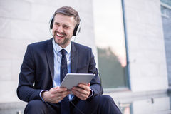 Handsome businessman relaxing Stock Image