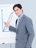 Handsome businessman reporting sales figures Stock Image