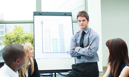 Handsome businessman reporting to sales figures Stock Images