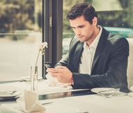 Handsome businessman in restaurant Stock Photos