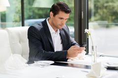 Handsome businessman in restaurant Stock Images