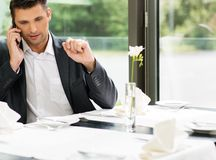 Handsome businessman in restaurant Royalty Free Stock Photography