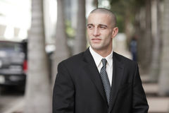 Handsome businessman with shaved head Stock Images