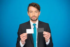 Handsome businessman showing blank business card Stock Photography