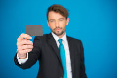 Handsome businessman showing blank business card Stock Images