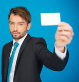 Handsome businessman showing blank business card Royalty Free Stock Photo