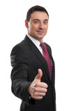Handsome businessman showing his thumb up Stock Photo
