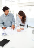 Handsome businessman showing a plan to his partner Stock Photo