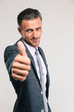 Handsome businessman showing thumb up Stock Image