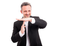 Handsome businessman showing time out Royalty Free Stock Image