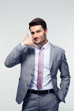 Handsome businessman shwoing call me gesture Royalty Free Stock Images