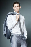 Handsome businessman in silver suit. Royalty Free Stock Photography