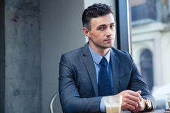 Handsome businessman sitting in cafe Royalty Free Stock Photos
