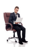 Handsome businessman sitting in chair with laptop Royalty Free Stock Photo