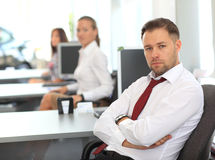 Handsome businessman sitting at desk Stock Photography