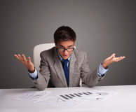 Businessman sitting at desk and doing paperwork Royalty Free Stock Photo
