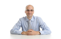 Handsome businessman sitting at a desk Royalty Free Stock Photography