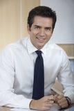 Handsome Businessman Sitting At Desk Stock Image