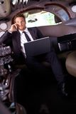 Handsome businessman sitting in limousine Stock Image