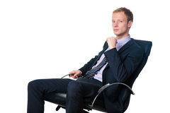 Handsome businessman sitting in office chair Stock Photography