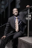 Handsome businessman sitting and smiling Stock Photo