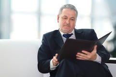 Handsome businessman sitting Stock Photos