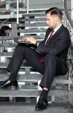 Handsome businessman sitting on the stairs Royalty Free Stock Image