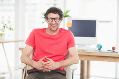 Handsome businessman sitting on a swivel chair and using his laptop Stock Photography
