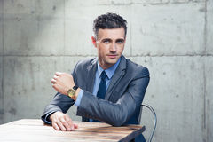 Handsome businessman sitting at the table Stock Photography