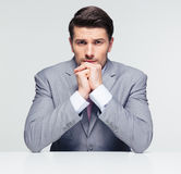Handsome businessman sitting at the table Royalty Free Stock Photos