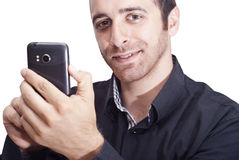 Handsome businessman with a smartphone Royalty Free Stock Photos