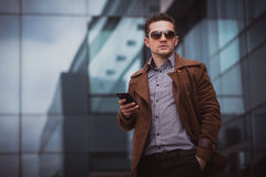 Handsome businessman with smartphone Stock Photography