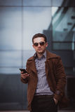 Handsome businessman with smartphone Royalty Free Stock Image