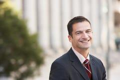 Handsome Businessman Smiling Stock Photo